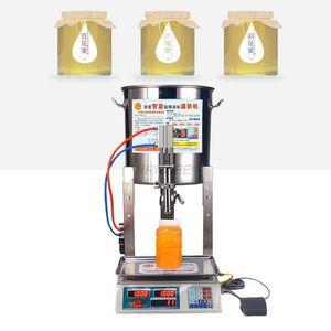 Multifonctionnel l'huile de sésame petite machine de remplissage de miel liquide machine de remplissage quantitative machine de remplissage en acier inoxydable