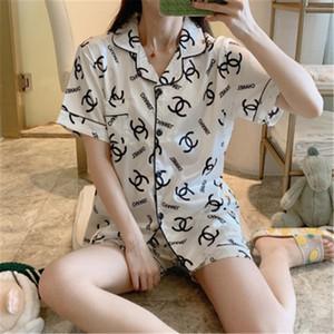 Raso di seta Coppia pigiama estivo Pijama Hombre Mens pigiama Set 2 1Pcss Solid stampata fiore Sleepwear SleepLounge manica lunga Abbigliamento sportivo P # 102