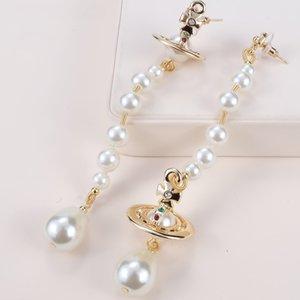 Europei e americani Regina Madre vw Vivienne Vivienne perla asimmetrica tridimensionale Saturno orecchino pendente NANA punk