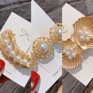 accesorios para el cabello estilo de la estrella de Corea del lado de perlas Pearl Spring pato secundarios femenina accesorios para el cabello clip de flequillo clip de estudiante