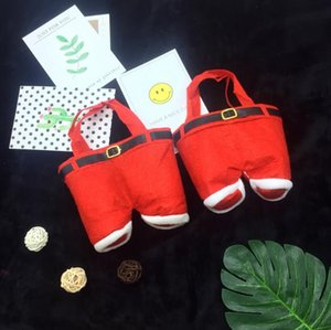 Christmas children are small and can be carried by hand like a hot red candy bag gift bag Santa pants pattern