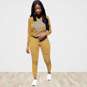 Femme Vêtements Femmes Designer Survêtements Mode capuche Sport 2PCS Ensembles en cours Printed Sweats à capuche Pantalons trou Costumes