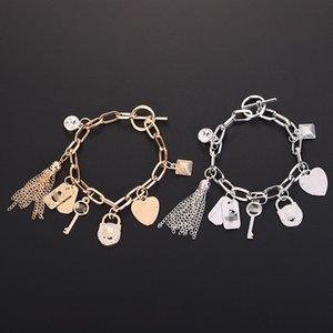 Bracelet en alliage Couple Variété de pendentifs pompon argent ou pendentifs plaqué or bijoux Charm Bracelets Bracelet pour les femmes cadeau CNY99