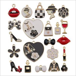 Mezcla de bricolaje joyería accesorios de los resultados del pendiente del pequeño colgante de labios blancos Negro Bolsa de aleación de los anillos dominantes encantos del corazón 23pcs KeyRing