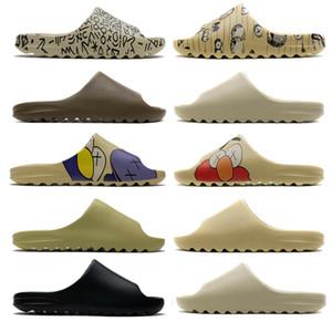 2020 Kaws diapositive Flip Kanyet occidentale resina diapositive Desert Sand Terra Brown Bone pantofole Panini del pane delle donne degli uomini sandali Outdoor Flops Size 5-11