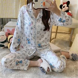 Parejas de seda del verano pijamas Set de manga corta impresa flor ropa de noche de los hombres y las mujeres sueltan el estilo llano Inicio Traje Pjs Mujeres Y200708 # 499