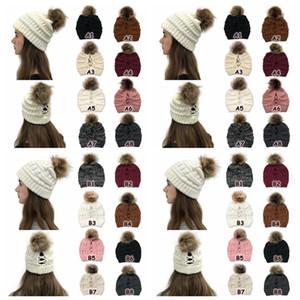 Çapraz Pom at kuyruğu kasketleri 16 Renkler Kadınlar Kış Yüksek Bun Örgü Şapka Ayrılabilir Ponpon kasketleri Parti Şapkası CCA12560 30pcs Criss