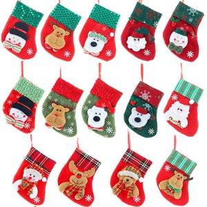 Santa Claus pequeña media de la Navidad del copo de nieve de Navidad Elk calcetines del árbol de Navidad de dibujos animados muñeca colgante decorativo de caramelo bolsa de regalo T9I00541 de niños