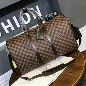 47CM النساء قدرة كبيرة أكياس الشهيرة الكلاسيكية Luxurys مصممي حقائب بيع حقيبة يد كتف الرجال من القماش الخشن تحمل الأمتعة keepall لالسفر