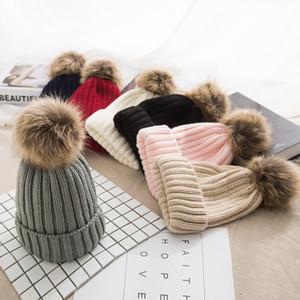 Mädchen-Frauen-Winter-Wolle-Beanie Cap wirkliche Waschbär-Pelz-Pom Pom Eltern-Kind-Strickmütze Kerngarn Warm Lässige Skullies Beanies Bones