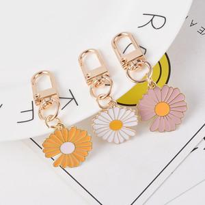 DIY creativo de aleación pequeña margarita Mobile Phone orejeras decoración colgante de la MUCHACHA bolsa colgante llavero