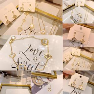 amantes IIggr titanio Stud nuevo acero Carta pendientes plateados ancha trébol de cuatro hojas pendientes collar de la edición brillante CHC Oro anillo abierto la pulsera