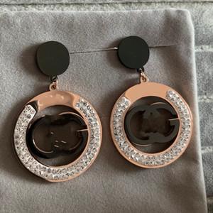 2021 grande modo di alta qualità europea Stati Uniti d'America in acciaio al titanio rosa di nozze di diamante orecchini pendenti in oro per le donne gioielli amanti degli uomini
