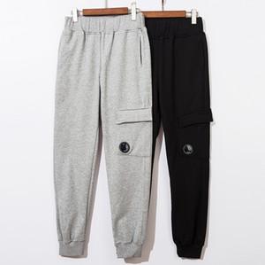 CP pantaloni della tuta pantaloni casuali degli uomini pantaloni della tuta azienda mens Pantaloni pantaloni cargo uomini che pareggiano leggings a vita elastica dei pantaloni di formato M-2XL