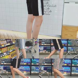 2019 Nueva Corea pantalones cortos de estilo casual de estudiantes de moda los pantalones cortos hasta los tobillos playa bfstyle par pantalones cortos de los hombres suelta Beach 1YIse 1YIs