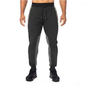 Calças estilo Vestuário geométrica painéis calça casual mens com cordão Designer Calças Lápis Cor Natural Ativo