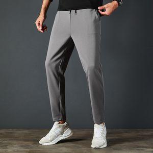 EQbyx uomini alla moda di sport casuali 9 punti autunno nuovi traspirante sport degli uomini 9-fen ku 9 fen ku 9 pantaloni pantaloni lunghi