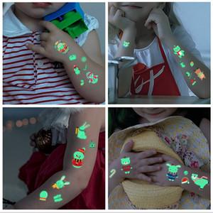 E92703 favor de partido de navidad etiqueta engomada del tatuaje del arte de cuerpo luminoso fluorescente impermeable tatuaje temporal de la etiqueta engomada de Halloween Niño Tatuaje