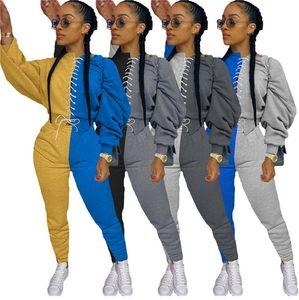 D91503 las mujeres chándal con capucha con cordón delantero del remiendo de la manga larga Sudaderas Pantalones de las polainas dos pedazos fijados Trajes de deporte
