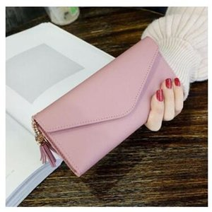 cc New simple ladies wallet ladies long three discount wallet soft leather tassel students Korean version of the lovely zero wallet card bag