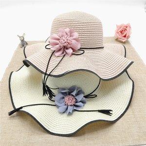 In stile coreano larga tesa mare spiaggia sole estivo fiore ondulato viaggio di paglia di Sun cappello di paglia cappello di marea di QmWuq Donne