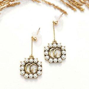Exquisite Perlen-Ohrringe klassischer Buchstabe-Ohrringe arbeiten Retro Party Ohrringe Exaggeration Studs Cubic Hohlschmuck Lady Kreis-Ohrring