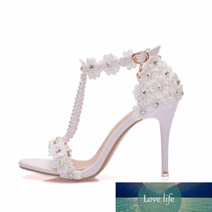 Crystal Queen Women Sandals White Lace Flowers Pearl Tassel 9cm Heel Fine High Heels Slender Bridal Pumps Wedding Shoes Y200323