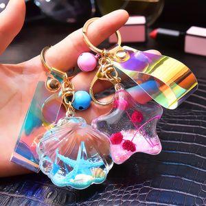 Portachiavi Quicksand Paillettes acrilico in olio Shell delle stelle marine portachiavi Magic Color Laser in pelle Rope Bag accessori del pendente