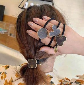 Nuevo diseñador de Corea del diseñador superior de cuerda de pelo de goma creativo geométrico de la flor del pelo lazos elásticos del pelo de las mujeres Carta joyería y accesorios