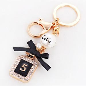 Botella de perfume creativo Llavero del encanto del bolso de las mujeres del Rhinestone Crystal Key anillo de la cadena dominante de la manera del sostenedor del coche Llaveros baratija