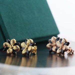 wholesale fashion earings high quality electroplating gold earrings women Titanium steel jewelry love earrings flower earring