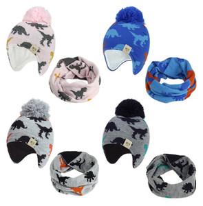 Dinosaurio de dibujos animados de bebé hechos punto sombrero de la bufanda caliente del invierno Conjunto Niño Niña Beanie forro polar del niño sombrero Niños con Pompón