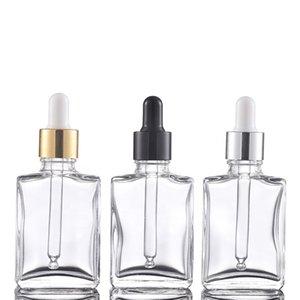 Venta caliente 400pcs transparentes botellas de vidrio con gotero Lot 1OZ 30ml Aceite Esencial de envase cosmético con Plata Oro Negro Tapas