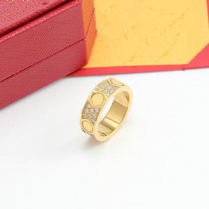Anillo de oro de 18 k anillo de pareja anillo de diamante con caja de titanio de alta calidad de acero de titanio de acero de acero de la moda de suministro de joyería
