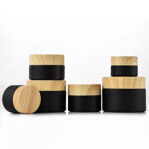 أسود متجمد زجاج الجرار مستحضرات التجميل مع أغطية بلاستيكية Woodgrain PP بطانة 5 جرام 10 جرام 15 جرام 20 جرام 30 50 جرام حاويات كريم بلسم الشفاه DWF2387
