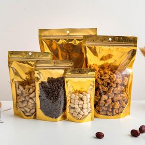 Bolsas de embalaje aluminizadas de la cremallera de oro portátil resalable Bolsas de almacenamiento de alimentos secos claros Bolsa de cremallera de almacenamiento a prueba de caramelo con agujero de colgar