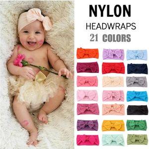 Mignon Filles extensible Twist Bandeau Bows 21 couleurs Nylon Bébé Bows cheveux Bonbons Couleur Gilrs headwraps M097
