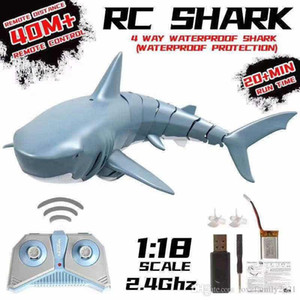 NEW 2.4G RC Simulation Shark Toys Remote Control Shark Boat Waterproof USB Rechargeable Swimming Pool Bathroom Toy Shark 1:18 Education toys