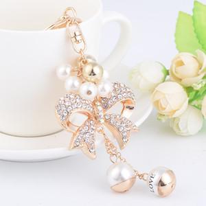 New Fashion ins luxury designer diamond rhinestone cute bow pearl bag charms tassel keychains white gold
