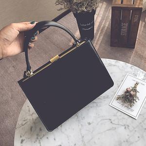 Bolsos de moda para mujer Bolsos de marco de metal diseño negro Oficina monedero de alta calidad PU cuero ladies hombro bolsas de mensajero C0121