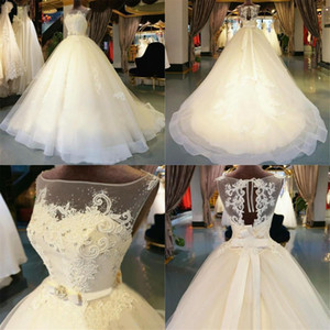 Plus Size Ball Gown Illusion Wedding Dresses Organza Appliques Floor -Length Chapel Train Zipper Beaded Crystal Bridal Gowns Custom