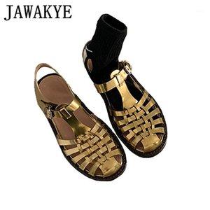 Cuero genuino Toe Round Toe Woven Roman Flat Sandals Mujeres Nuevo 2020 Golden Retro Plana Ladies Zapatos de verano T Show Gladiator Sandals1
