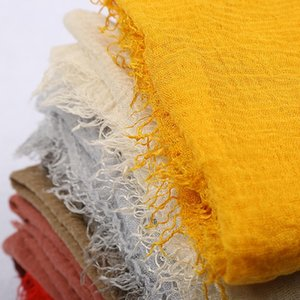 New design hot sale pure color cotton and linen creased scarf hot style hairy brim creased gauze scarf monochrome scarf
