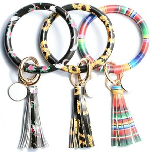 Creative PU leather bracelet key chain Ring, round piece, oil dripping, fringed pendant, cross-border hot selling bracelet