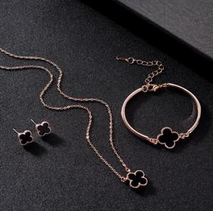 Zweifarbige optionale koreanische Version Heißer Verkauf Mode Vierblatt Blume Armband Halskette Ohrringe Schmuckset Set Nette Modeschmuck Damen Geschenke