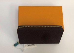 Luxurys Designers Femmes Portefeuille Vente en gros Mode Single Zipper Simple Hommes Cuir Portefeuille Lady Mesdames Porte-monnaie longue avec boîte orange Carte 60017