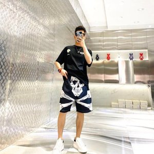 Spring and summer men's casual fashion beach pants 2020 new style creative skull head loose five point shorts