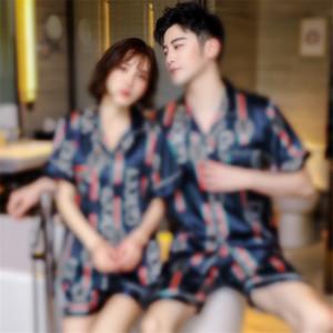 Vente en gros - Winter Femmes Mens Couple Couple Soie Pyjamas Costumes Ensemble Vapel Solide Manches Longues Manches Chinese Dragon Imprimerie Pijamas Pyjamas Sleelewear # 70611111