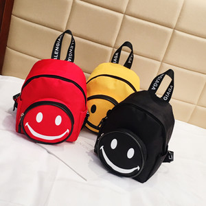 Children's portable school bag Korean version of the trend travel small backpack cute smiling face backpack