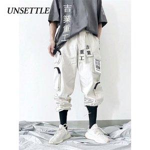 Unsattle Japão Hip Hop Jogadores Homens / Mulheres Harem Calças Multi-bolso Sweetpants Streetwear Casual Mens Cargo Calças 201110